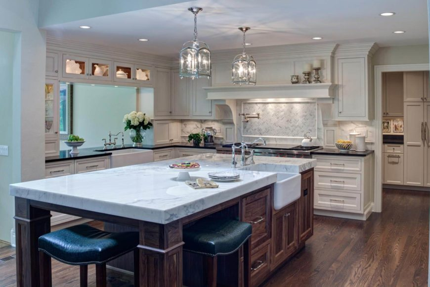 Immense Dark Wood Island With Thick Slab Marble Countertop And Built In  Sink Dominates This Part 33