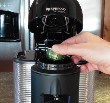 Placing a capsule in the Nespresso Vertuoline