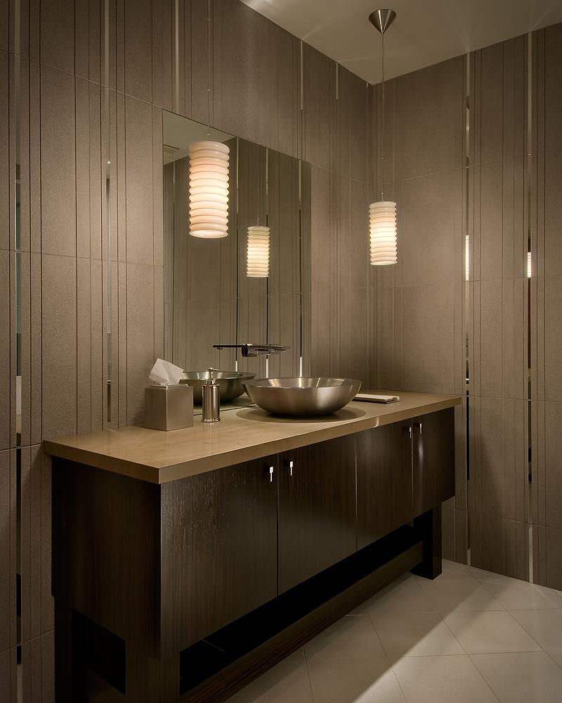 Bathroom features a custom vanity with steel