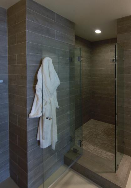 Bathroom features large walk-in glass door shower cove.