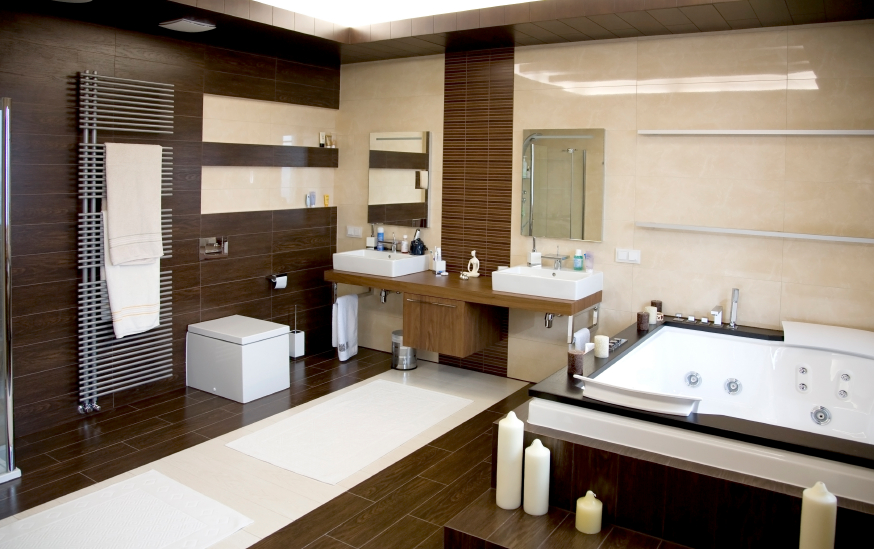 Bathroom with matching floor and wall panels and floating dual vanity