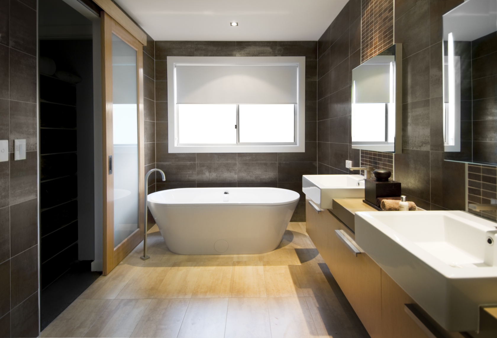 modern bathroom features a bold mixture of bright natural wood from flooring tiles to floating - Modern Bathroom