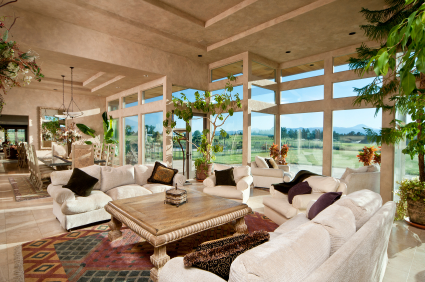 luxury family room with floor to ceiling windows and white sofas