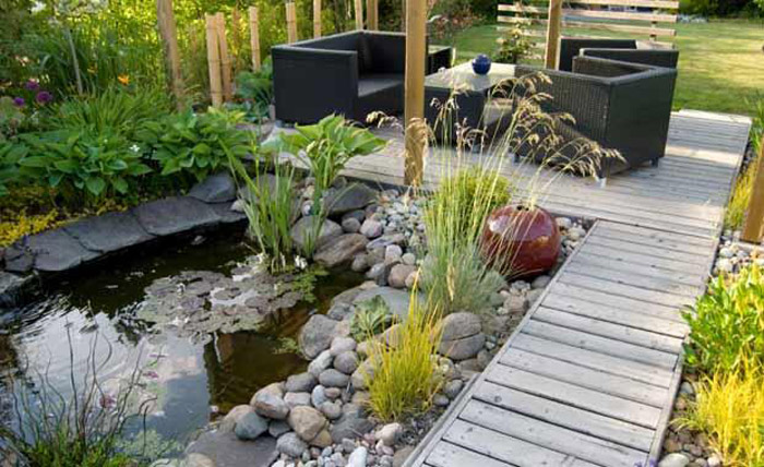 Lily pond next to wooden deck patio.