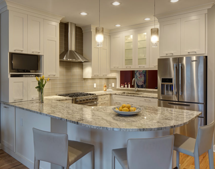 Bright Kitchen Design Features L Shaped Countertop Wrapping The Space, With  Curved Bar Style