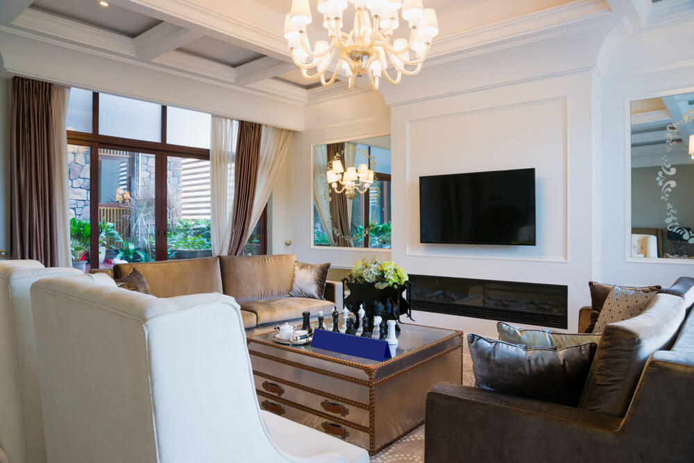elegant white living room hangs a lampshade chandelier and twin