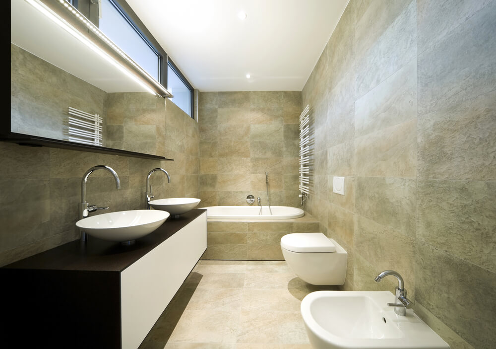 Marvelous Stone Tile Bathroom Cuts A Long, Narrow Path In This Home. Floating Dark  Wood
