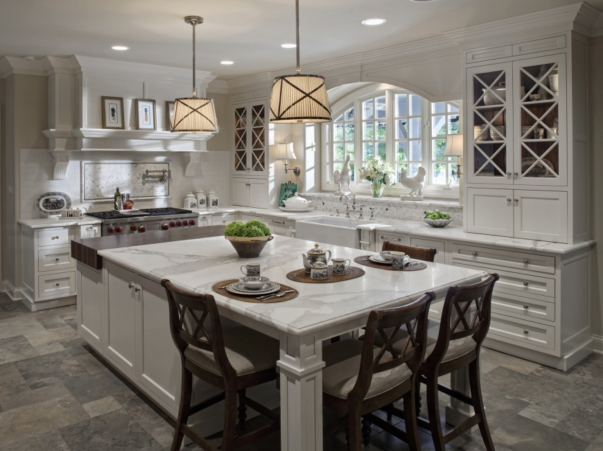 Wide Open Design Allows This White Kitchen To Stand An Immense Marble Topped Island At Center