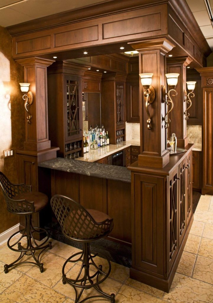 The Raised Soapstone Bar Countertop Here Stands Flanked By Carved Wood  Pillars, With A Pair