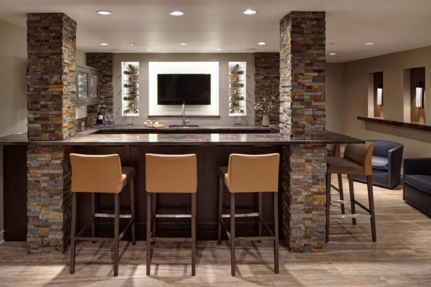 Maple Cabinetry And Quartzite Countertops Are Framed By Four Stone Brick  Columns. An Array Of