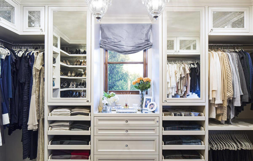 With Ivory Colored Cabinetry And Detailed Drawer Surfaces This Luxurious Closet Provides A Bright
