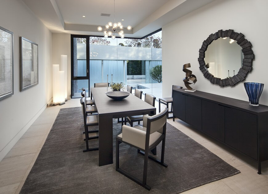 Separated Dining Room With Minimalist Dark Wood Table Large Mirror Hangs Above Buffet