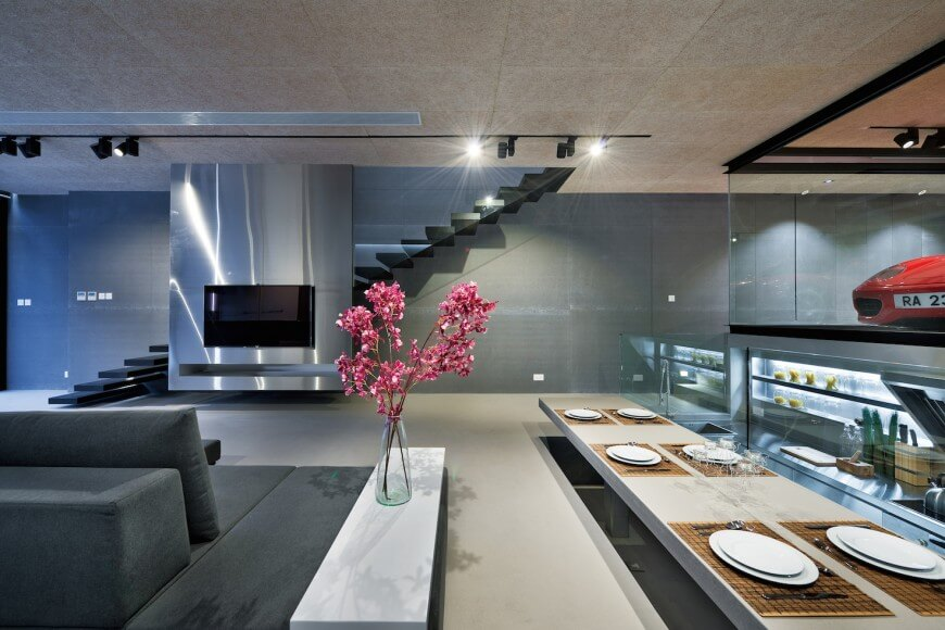 an open dining room with lowered dining table kitchen and living room areas off to - Open Dining Room