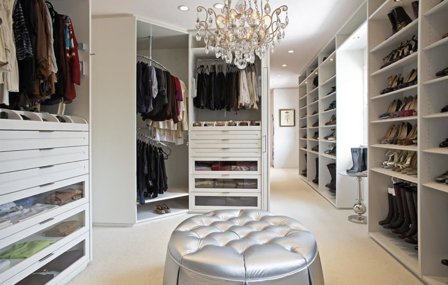 this classically white closet features an innovative corner carousel pull out belt trays - How To Design Walk In Closet