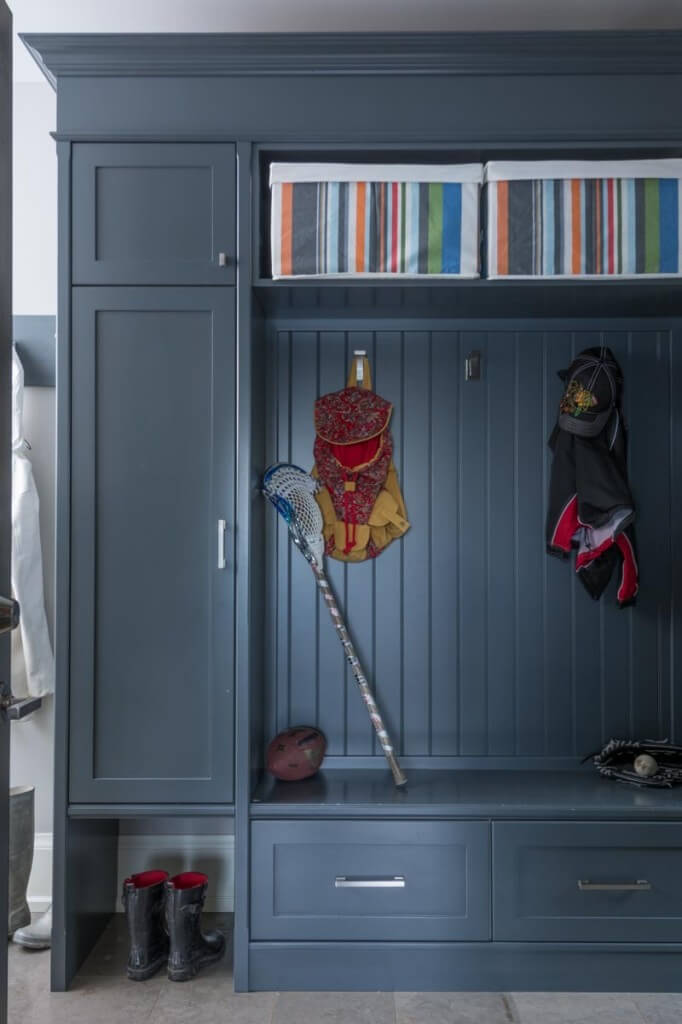 The mudroom/entryway cabinetry and shelving holds boot space, storage, and hangers for all manner of equipment and outdoor gear.