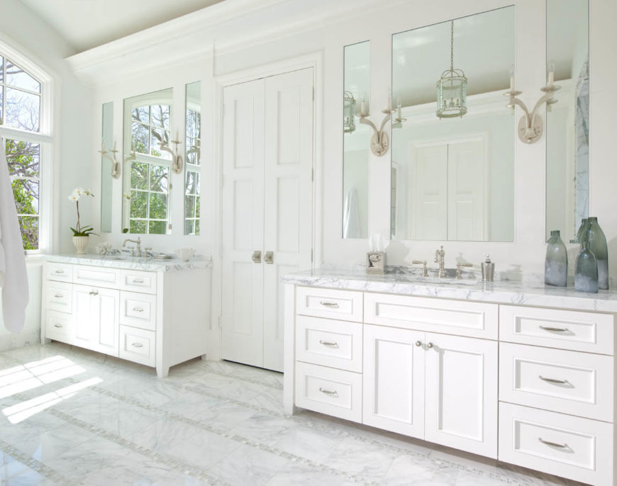 Carrera marble countertops on the dual white cabinet vanities stand