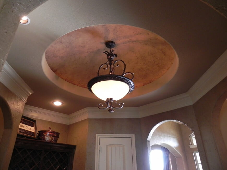 ceiling domes with lighting. adobestyle walls lead up to white crown molding and a ceiling domes with lighting