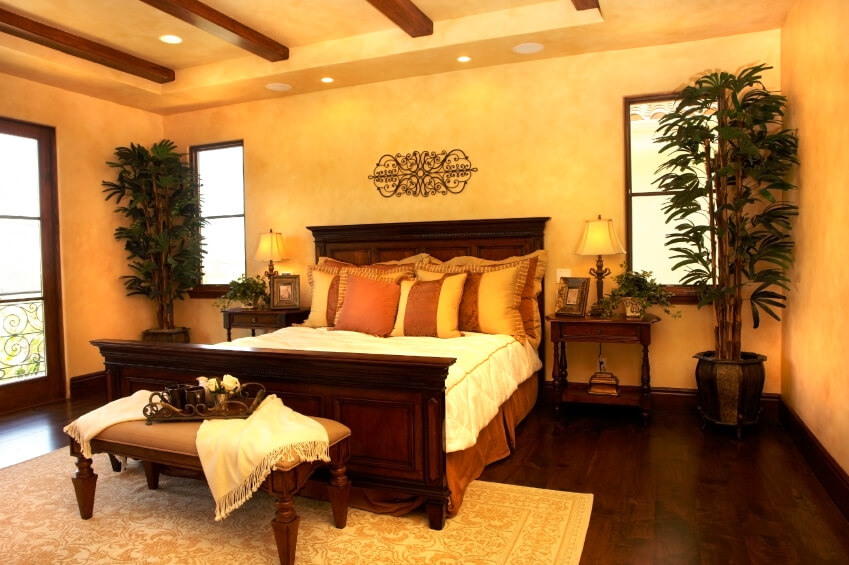 floor coverings contrast with the rich dark hardwood floors and