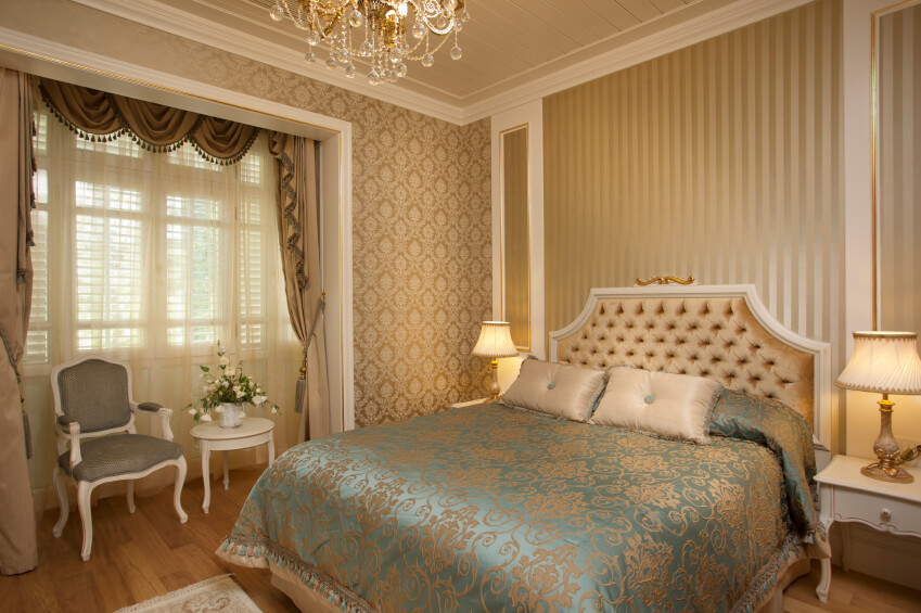 Silky beige and blue bedding and upholstered headboard combined with ...