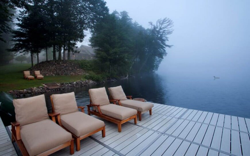 An extended dock allows for ample patio seating right on the lake itself, secluded from the main home by a large berm and trees.