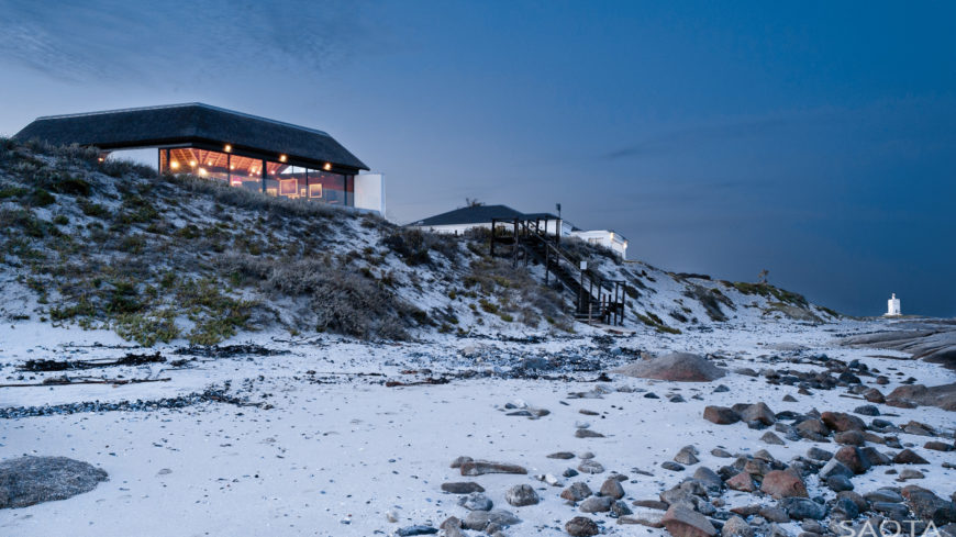 Open-design Silver Bay Home by SAOTA viewed from the beach.