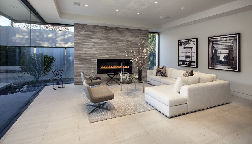 this ultra modern family room pairs a white l shaped contemporary sectional with a