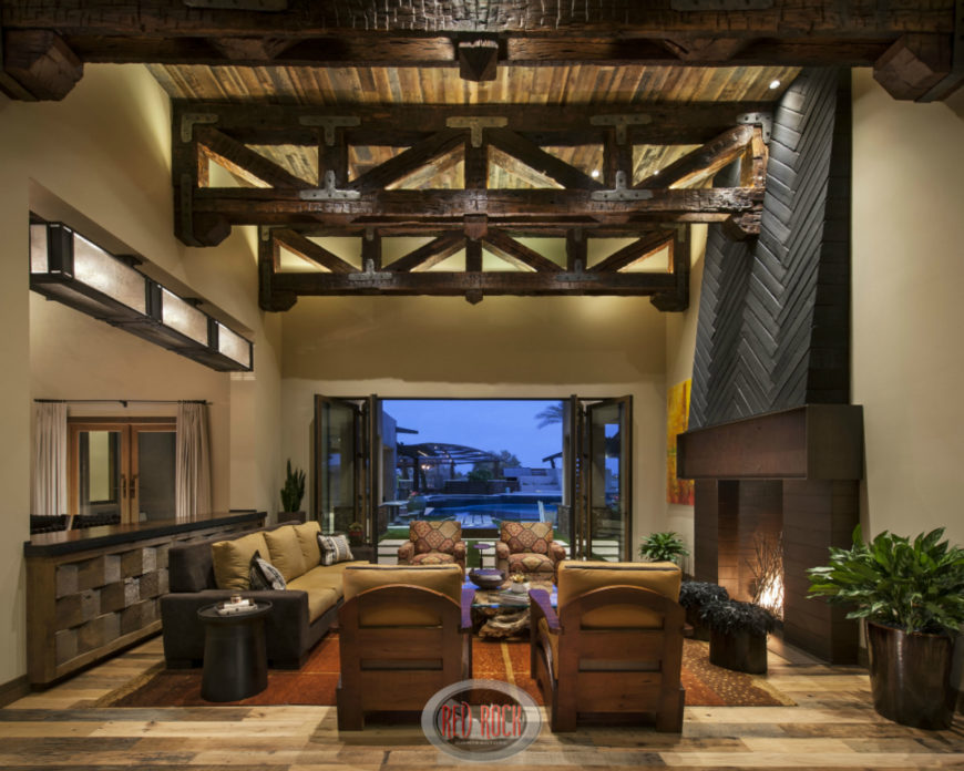 This Immense Contemporary Rustic Living Room Hangs Weathered Exposed Wood  Beams High Above A Space Filled