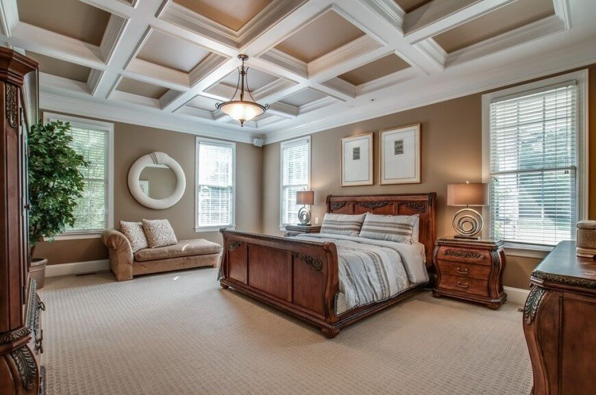 This bedroom has a low carpet with a subtle square pattern The