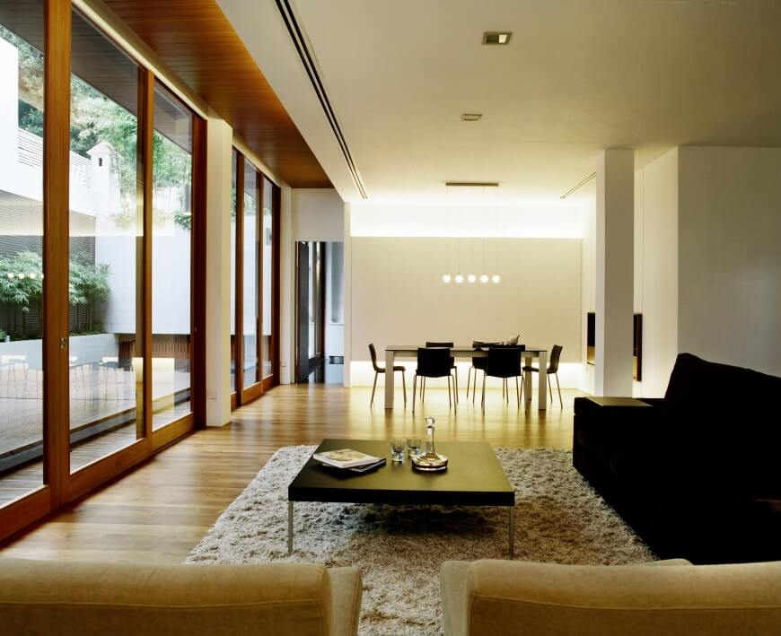 This Luxurious Living Room Arranges A Spare Set Of Richly Detailed Furniture Including Black Sofa