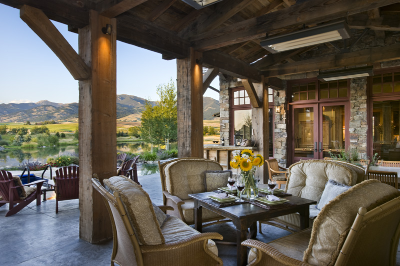 the house, you reach a larger covered patio, again with rustic wooden ...