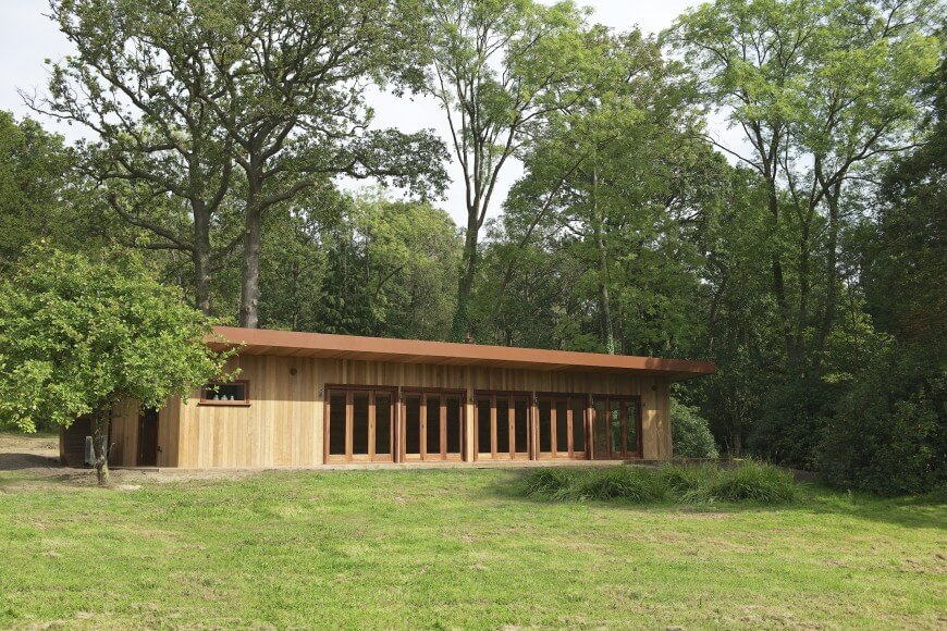 Viewed from across the garden, near the main home, the natural hued structure is an unassuming yet striking fixture in the environment.