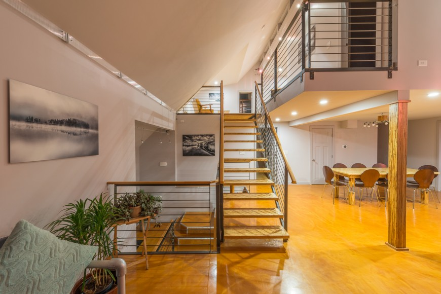 The open stairwell gives the home a connected feeling. People on all floors can easily interact with one another.