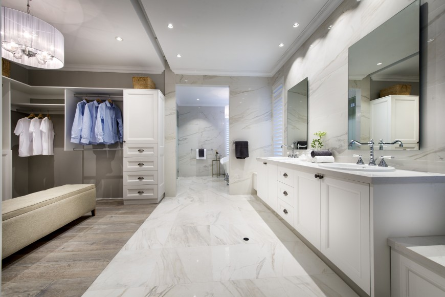 The marble floors turn back into the grey hardwood floors in the large walk-in closet.