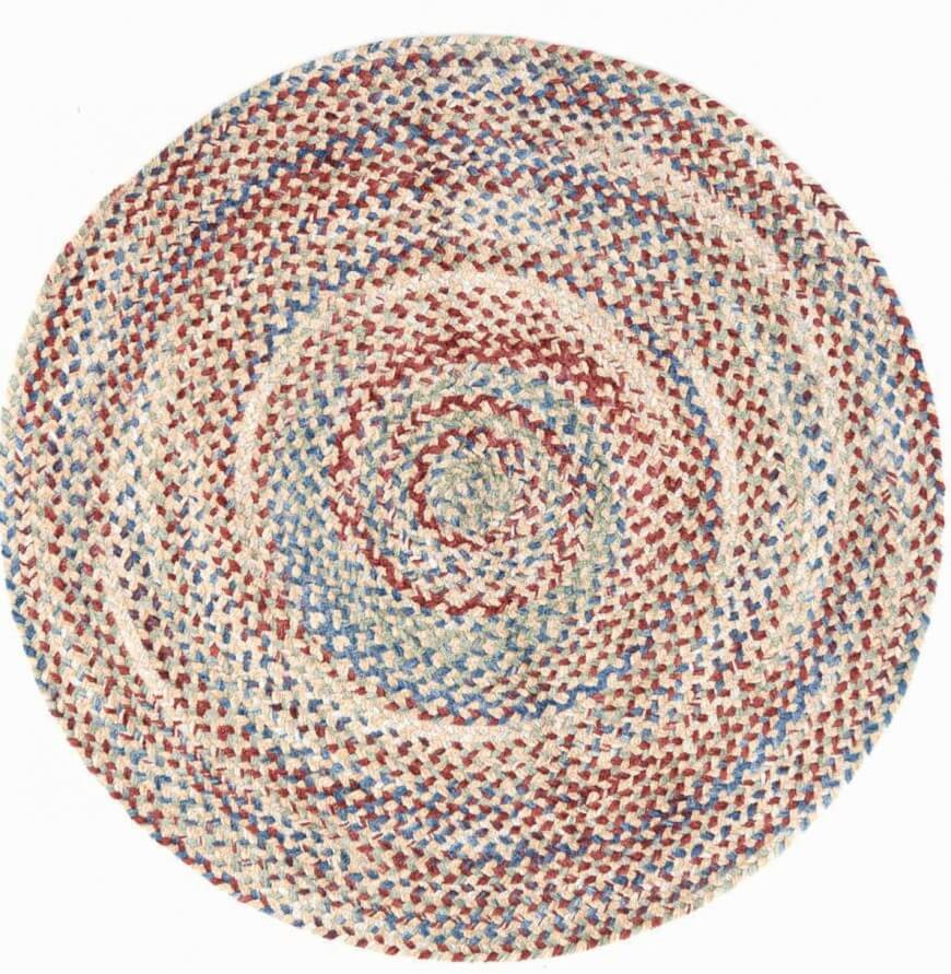 Braided rugs area sub-category of woven designs, featuring a cross braided design in the weave. This makes for often intricate, highly detailed patterns. Our round example model features a bursting pinwheel of color that complements the shape.
