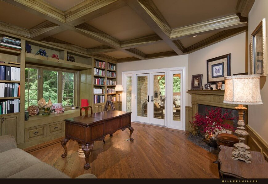 The study has a gorgeous coffered ceiling, fireplace, and window seat. The ornate solid wood desk is the centerpiece and crown jewel of the room.