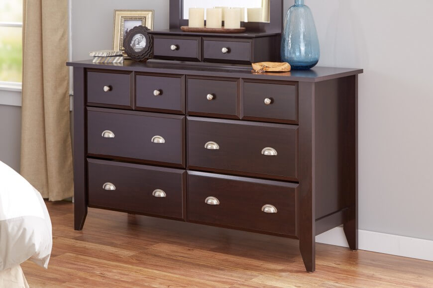 The standard dresser design came from one of the oldest pieces of furniture invented: the chest. These are horizontally oriented, squat in profile, and contain usually two columns of drawers.