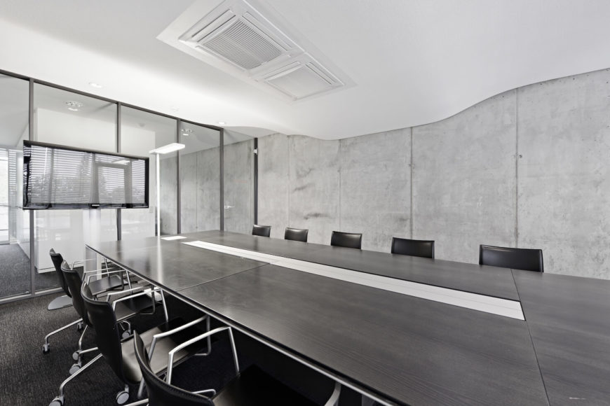 Throughout the office bare concrete pairs with stark white and black tones for a & Remarkable Modern Corporate Office Interior Design