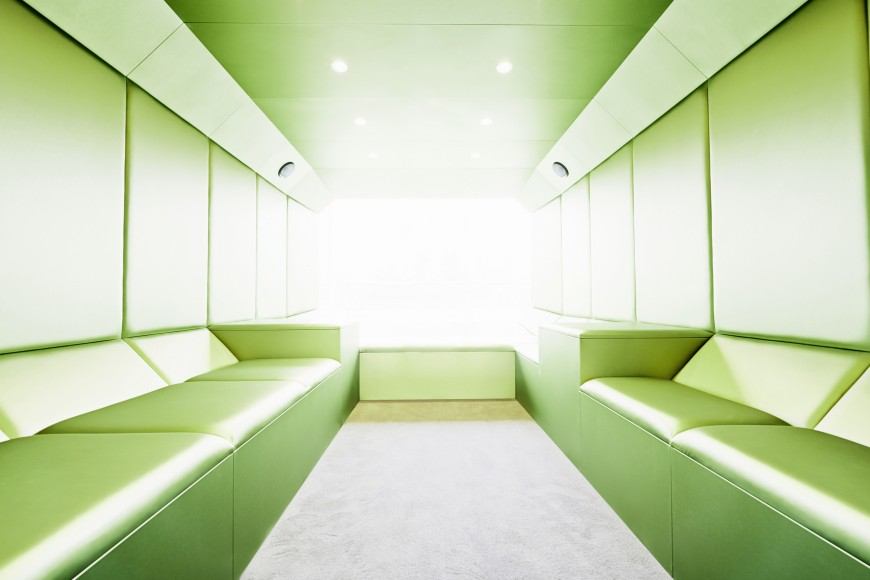 Inside of the lounge is wrapped in lime green leather cushioning, for a light burst of color upon entering the space.