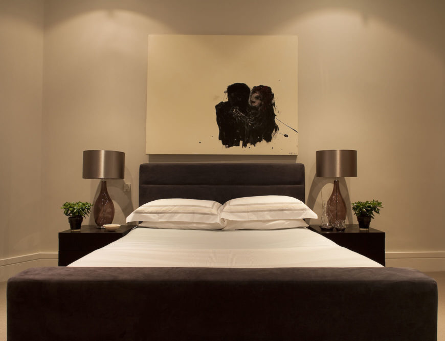 Above the bed, another painting of stunning imagery pairs with the elegant minimalism of the surroundings.
