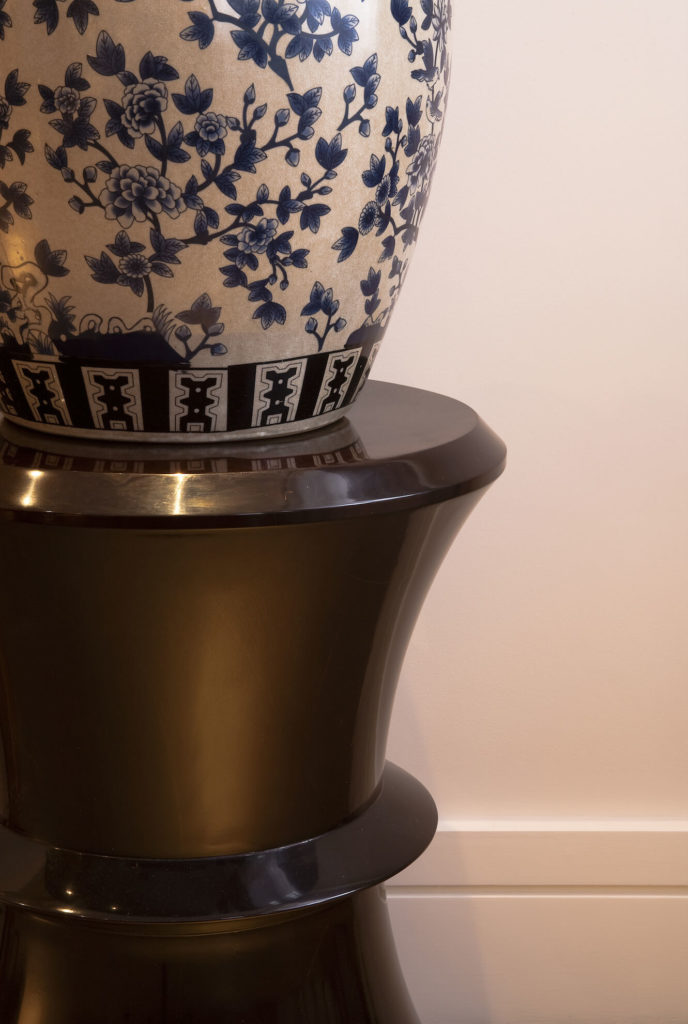 We leave you with a final image, a close view of an Asian vase on a bespoke circular table, reinforcing the theme running through the interior design.