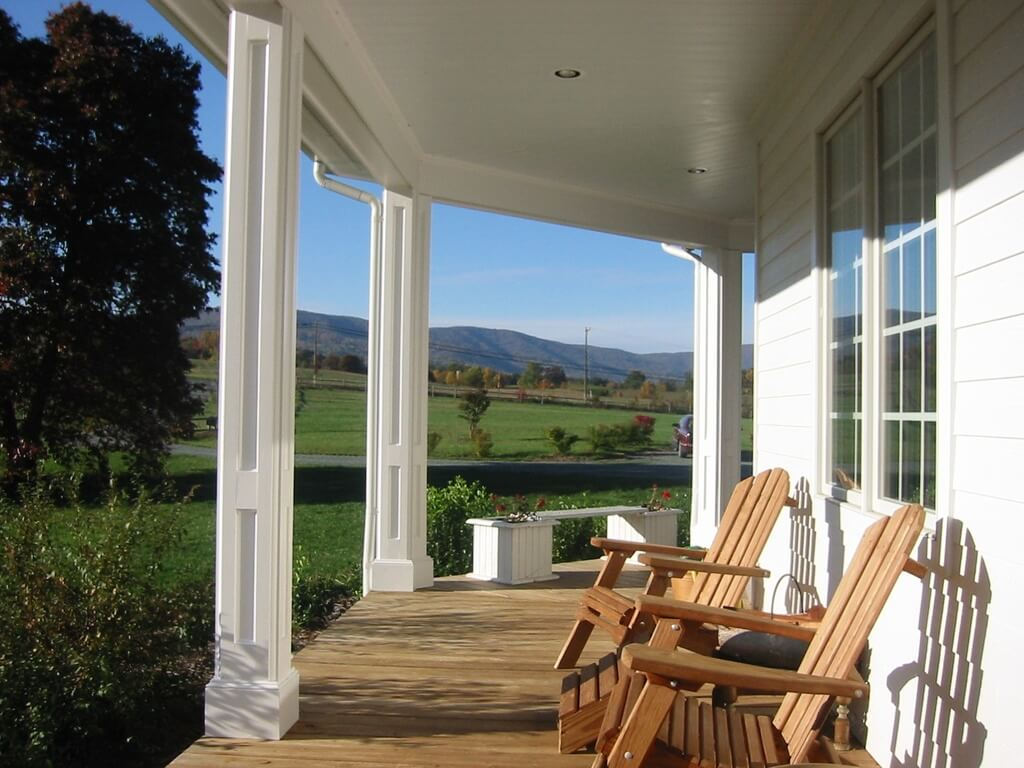A Veranda With A Lovely Country View A Bench Seat Is Visible To The Back