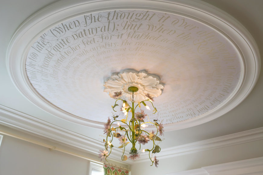 The circular section inside the trim has a spiraling passage from Alice In Wonderland that gets smaller the closer it gets to the unique light fixture. The light fixture has vines, flower buds and small lights designed to look like flowers.