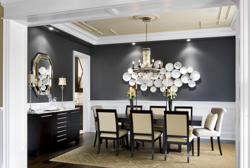 The formal dining room has white wainscoting around the bottom of the ...