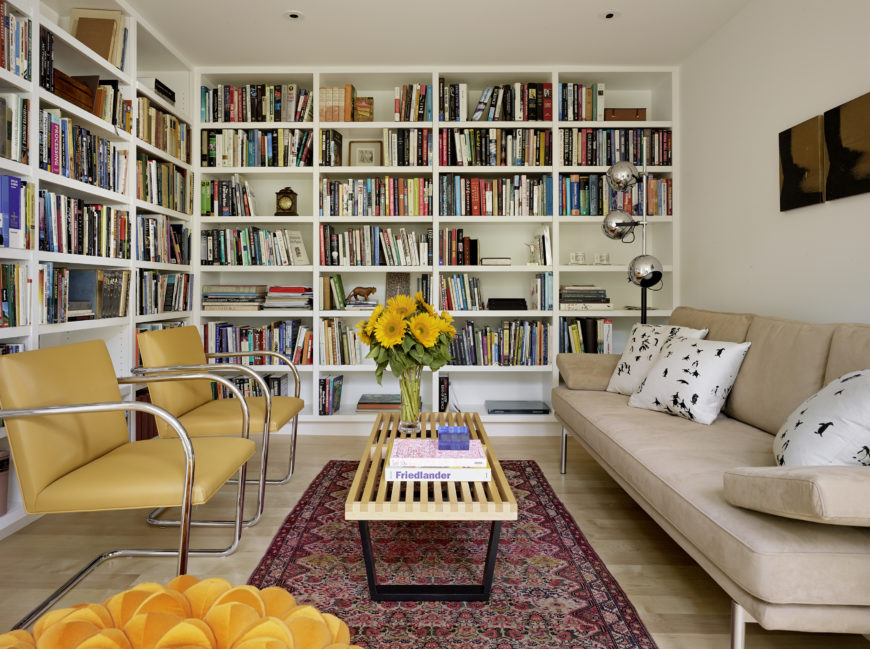 The L Shaped Bookcases Take Up Two Of The Three Walls Of The Room And