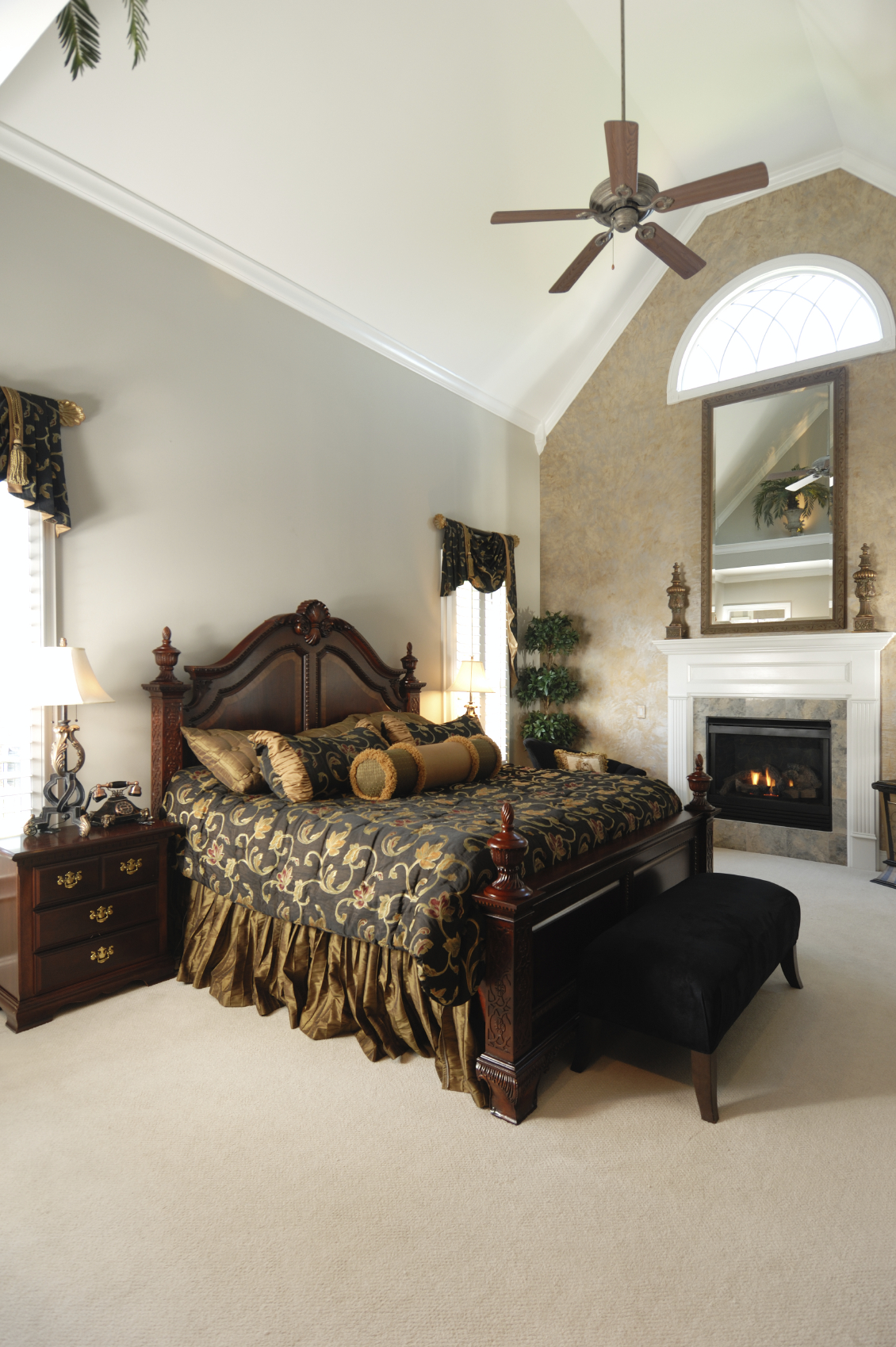 Bedroom stone fireplace - The Soaring Cathedral Ceilings Keep The Dark Furniture And Dark Bedding From Making The Room Feel