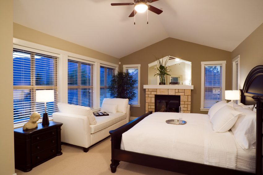 This master bedroom is dominated by the bed in a gorgeous cherry wood