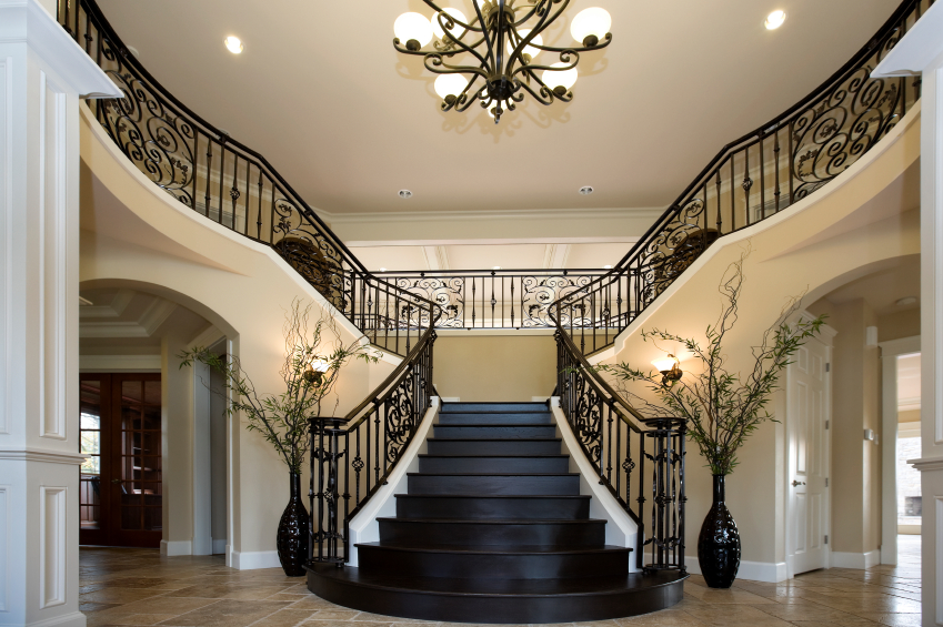 This Luxurious Foyer Has Black Treads On The Stairs That Match The The
