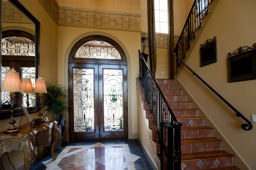 this ornate tuscan style foyer has gorgeous tile floors a tile staircase and - Foyer Tile Design Ideas