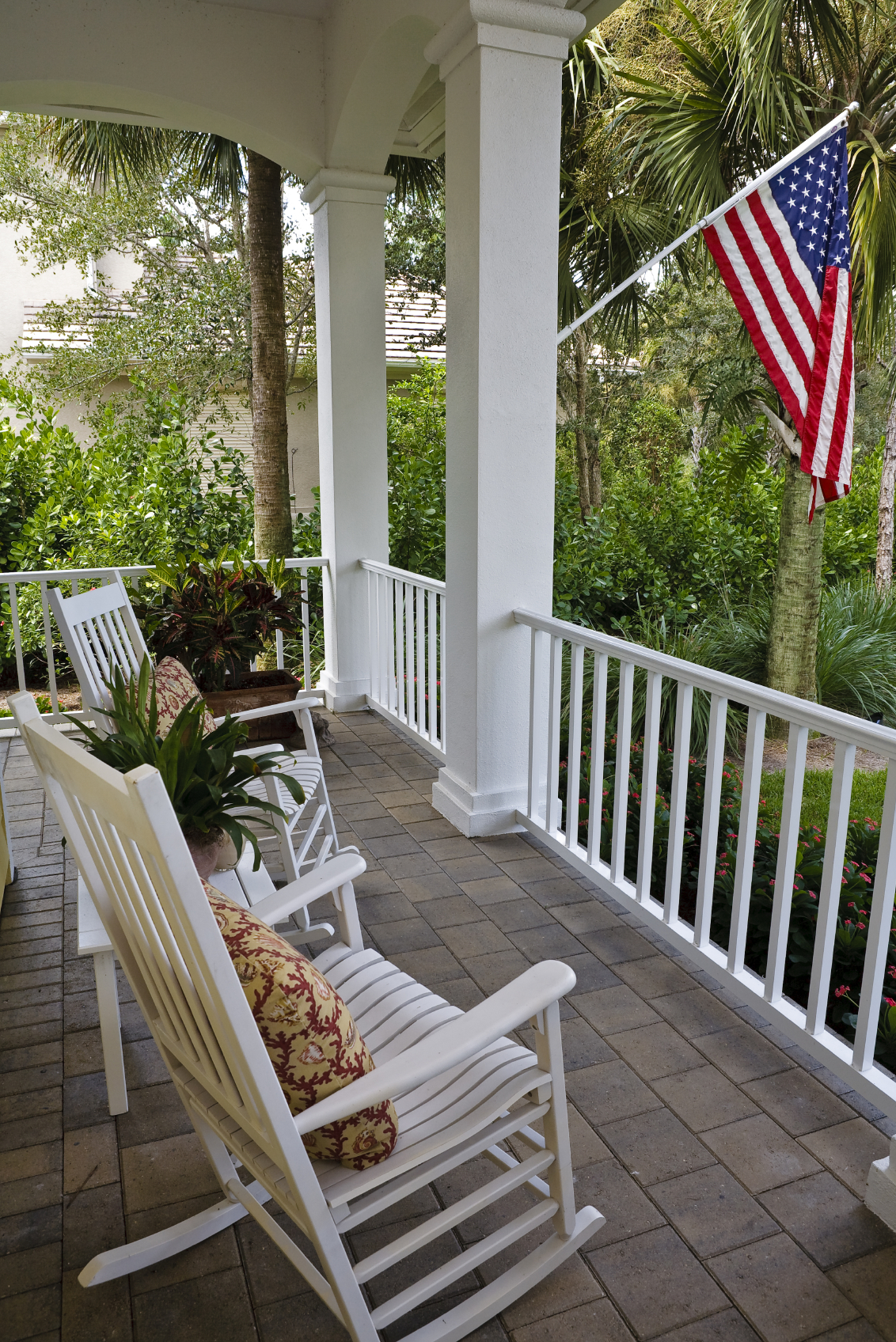"This porch is similar to a covered patio, with ""windows"" and a ..."