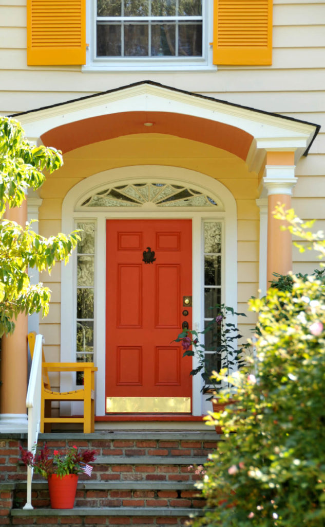 This Front Door And Entryway Has Six Panels With A Gold Metallic Kick  Plate. The